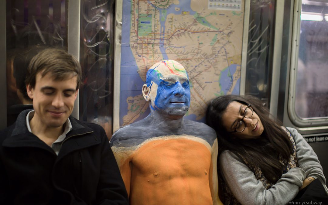 Near-Nude Man Painted to Camouflage on Subway Train, New Yorkers Unfazed